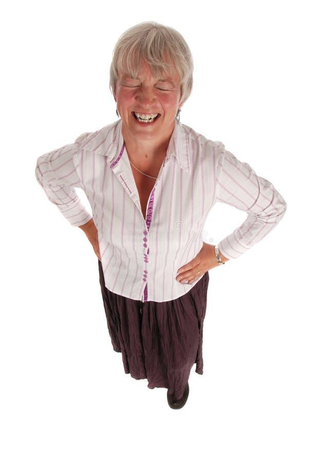 Donna maggiore di risata di affari su bianco fotografia stock libera da diritti