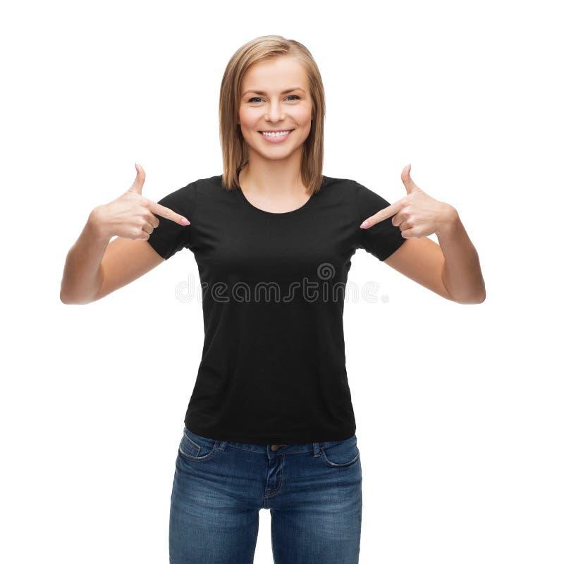 Donna in maglietta nera in bianco fotografia stock