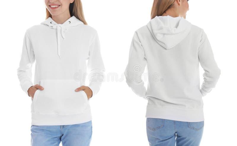 Donna in maglione in bianco di maglia con cappuccio su fondo bianco, primo piano fotografia stock libera da diritti