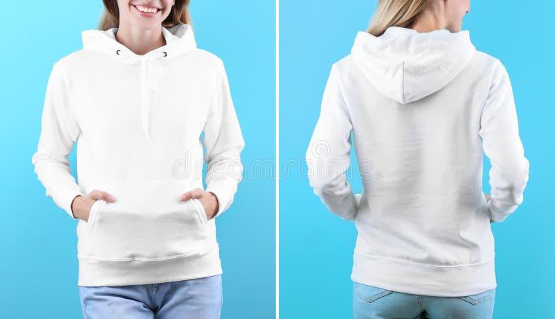 Donna in maglione in bianco di maglia con cappuccio sul fondo di colore, primo piano fotografia stock