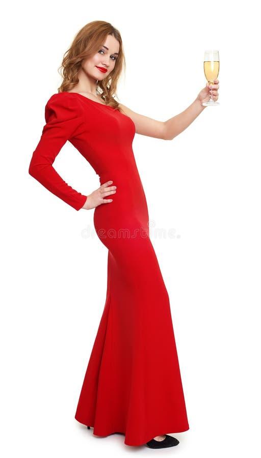 Donna nel rosso con il vetro del champagne su bianco immagini stock