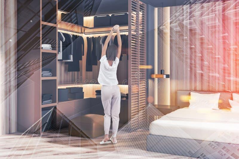 Donna nell'angolo della camera da letto principale con il guardaroba royalty illustrazione gratis