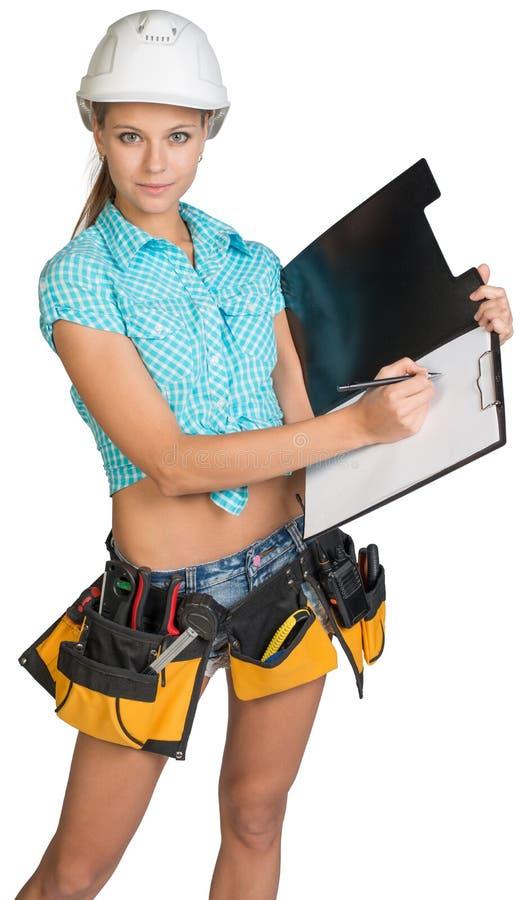Donna nella scrittura della cinghia dello strumento e del casco sullo spazio in bianco fotografia stock
