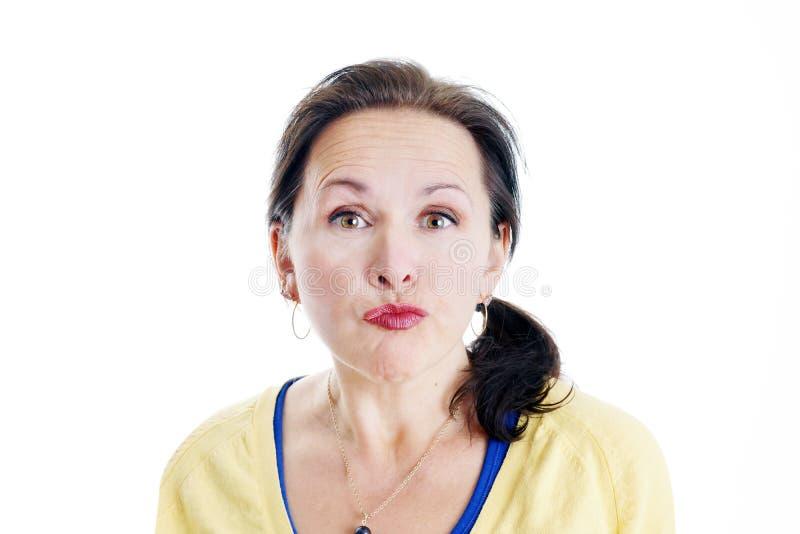 Donna non impressionata fotografia stock