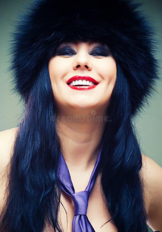 Donna in protezione della pelliccia fotografia stock