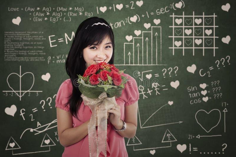 Donna romantica con i fiori fotografia stock