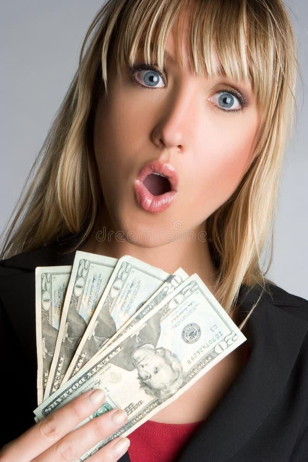 Donna scossa dei soldi immagine stock