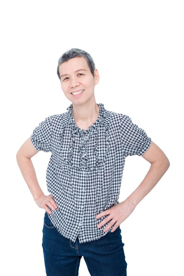 Donna senior che sorride sopra il bianco immagine stock libera da diritti