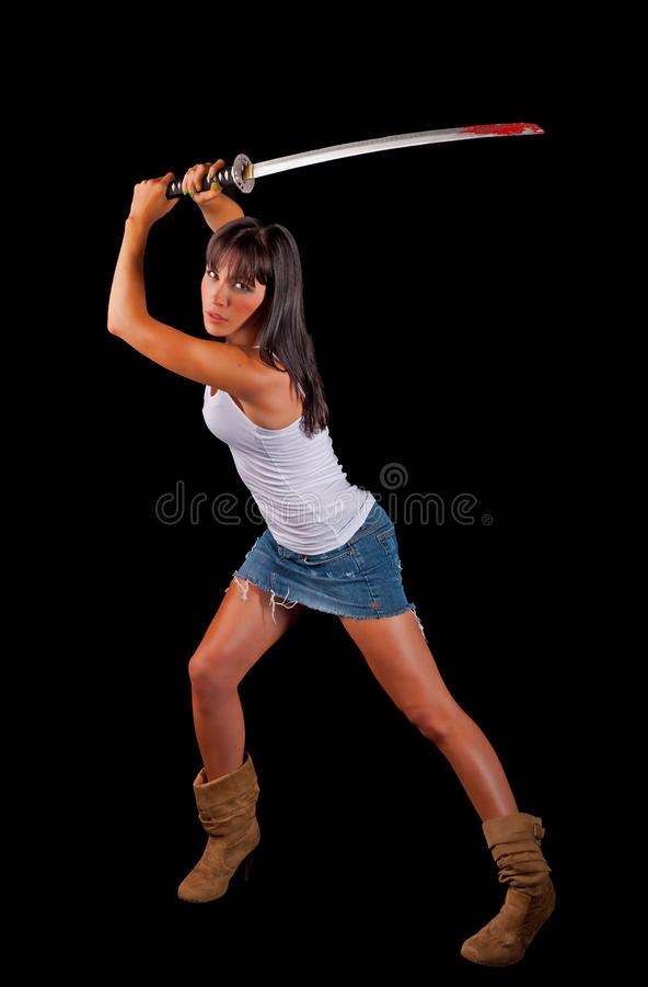 Donna sexy con una spada del samurai fotografia stock
