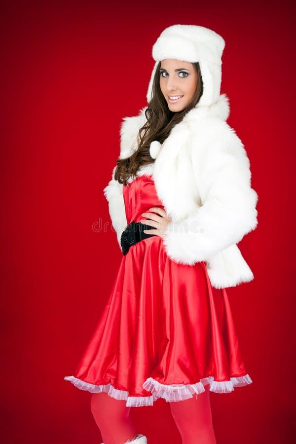 Donna sexy della Santa con il cappello bianco immagine stock