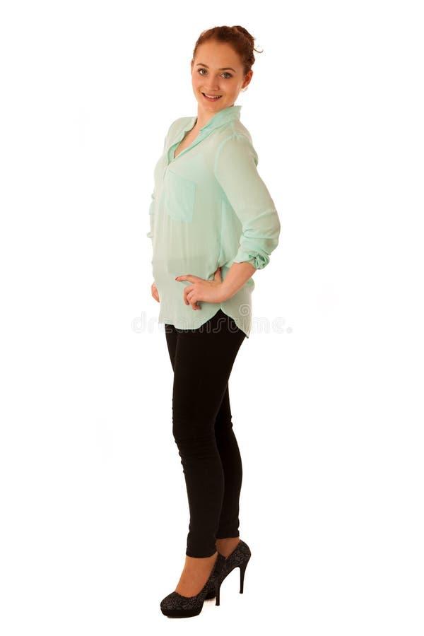 Donna sicura attraente di affari con capelli marroni che stanno iso fotografia stock libera da diritti