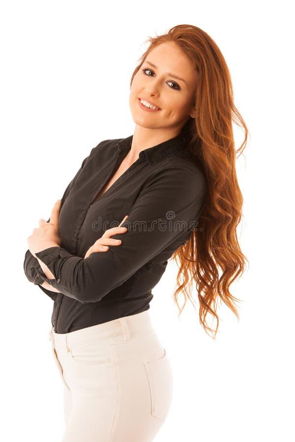 Donna sicura attraente di affari con capelli marroni che stanno iso immagini stock