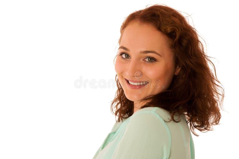 Donna sicura attraente di affari con capelli marroni che stanno iso fotografie stock
