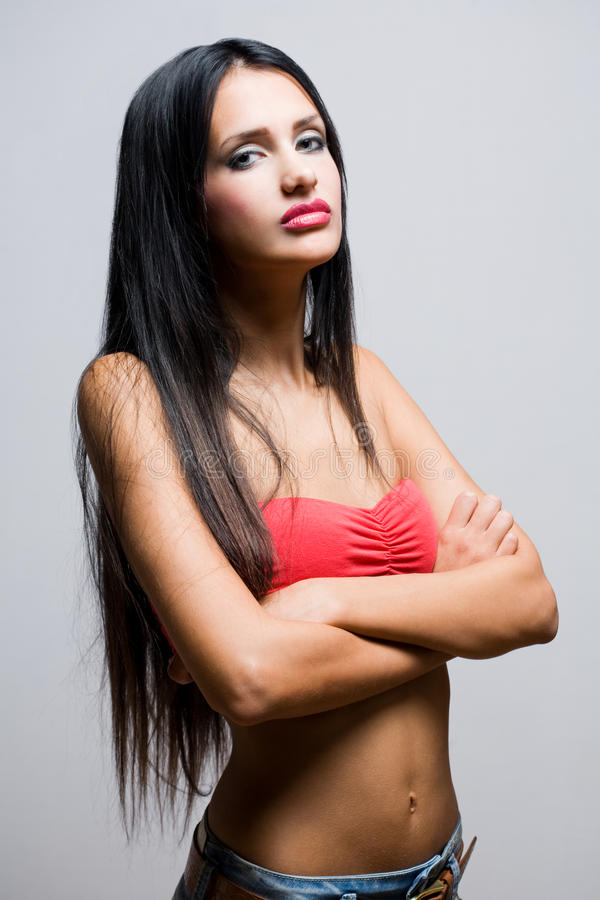 Donna snella sensuale del brunette. fotografia stock