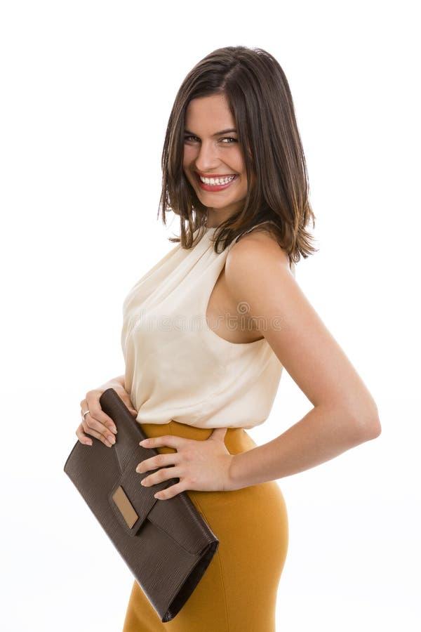 Donna sorridente con la borsa fotografie stock libere da diritti