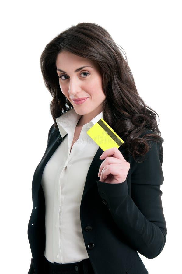Donna sorridente con la carta di credito fotografia stock