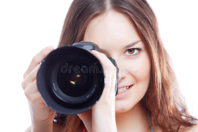 Donna sorridente con la macchina fotografica professionale fotografia stock