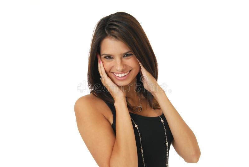 Donna sorridente con le mani sul fronte fotografia stock