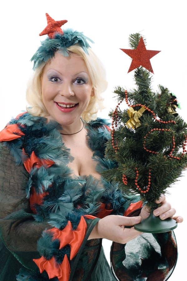 Donna sorridente in costume dell'albero di Natale immagine stock libera da diritti