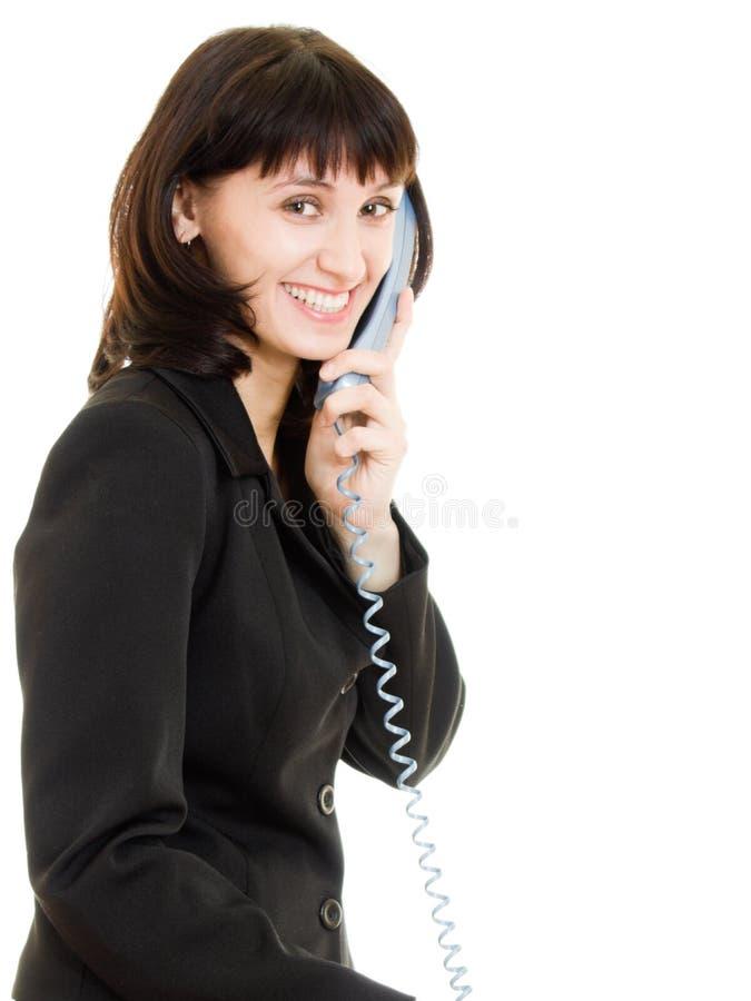 Donna sorridente di affari che comunica sul telefono immagini stock