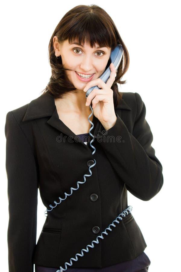 Donna sorridente di affari che comunica sul telefono immagine stock