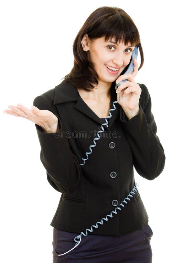 Donna sorridente di affari che comunica sul telefono fotografia stock