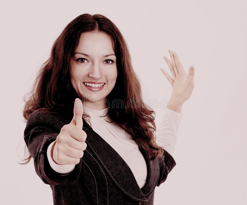 Donna sorridente di affari che mostra pollice su Su un bianco immagine stock libera da diritti