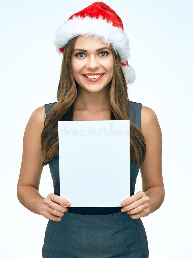Donna sorridente di affari della ragazza di Santa che tiene advertisin in bianco bianco fotografie stock
