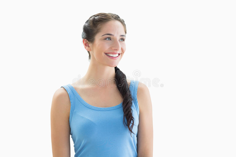 Donna sorridente nel distogliere lo sguardo blu della canottiera sportiva fotografie stock