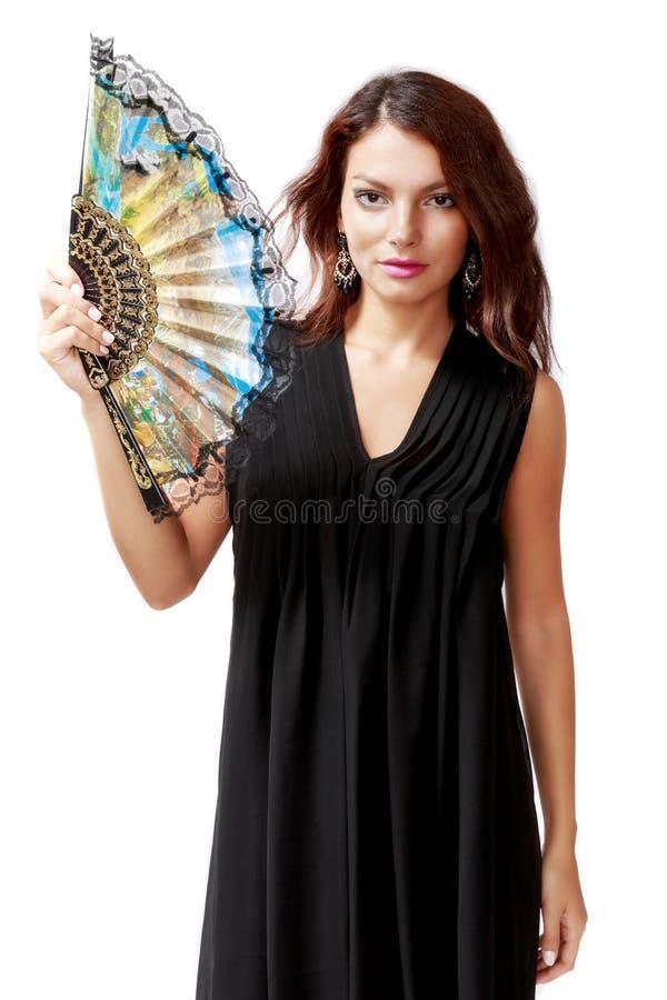 Donna spagnola con un fan e un vestito nero fotografia stock