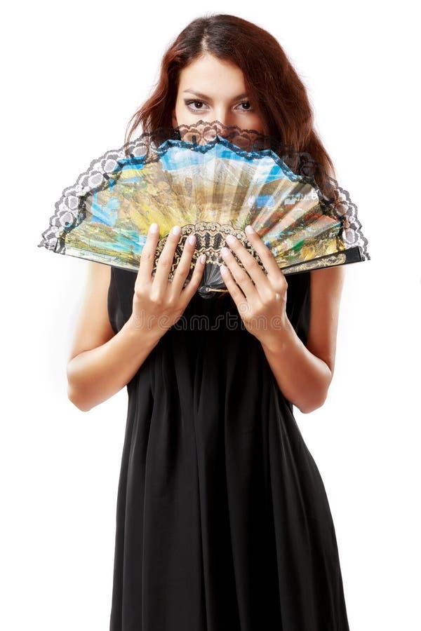 Donna spagnola con un fan e un vestito nero fotografia stock libera da diritti