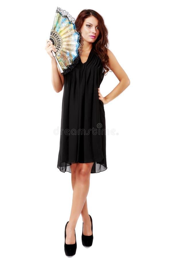 Donna spagnola con un fan e un vestito nero fotografie stock libere da diritti