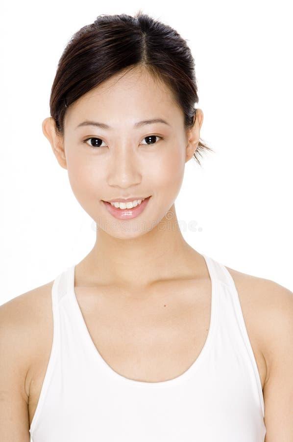 Donna sportiva sorridente immagine stock