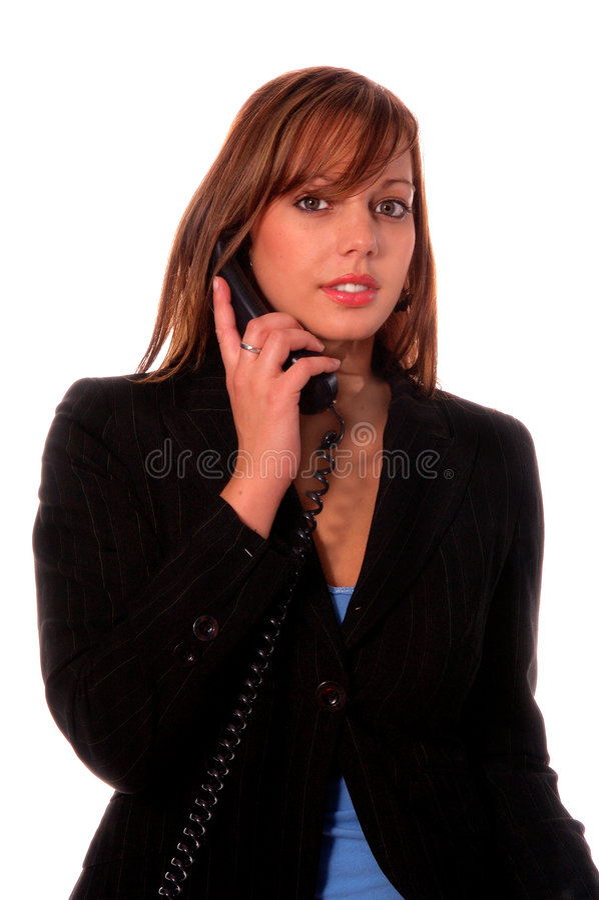 Donna su un telefono Corded immagini stock