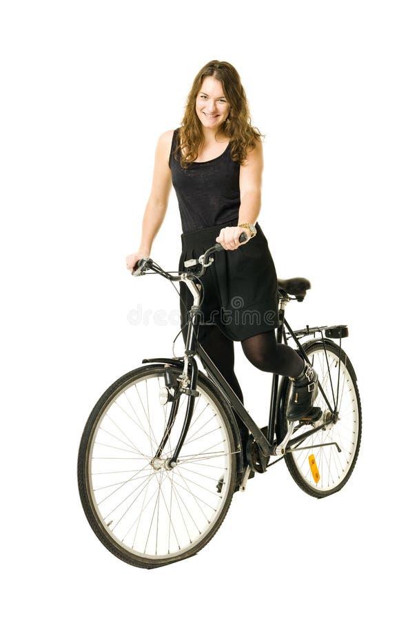 Donna su una bicicletta fotografie stock libere da diritti