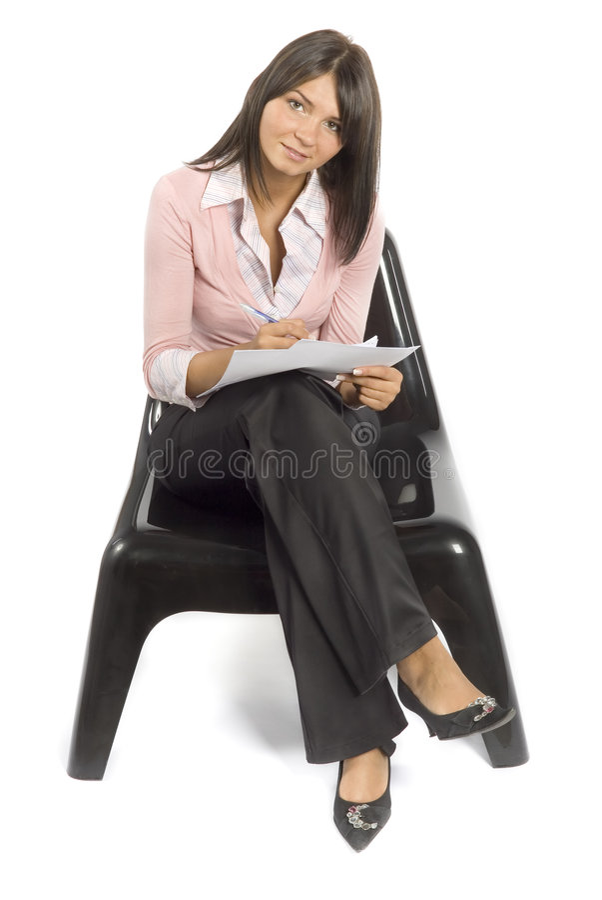 Donna sulla presidenza che fa avviso fotografia stock