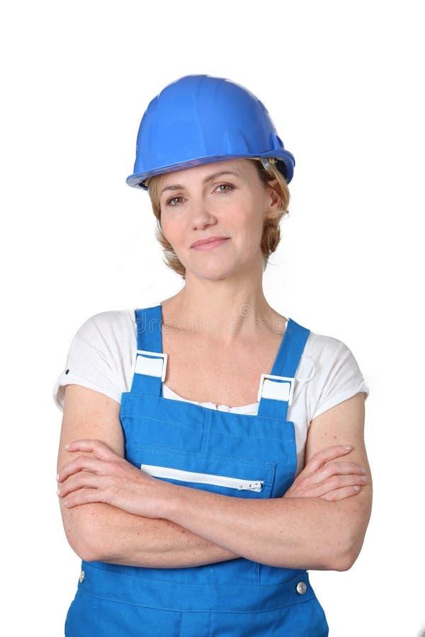 Donna in vestiti da lavoro immagini stock
