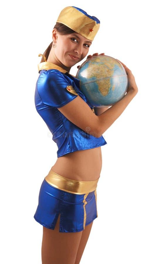 Donna in vestito blu con il globo, vista laterale immagine stock
