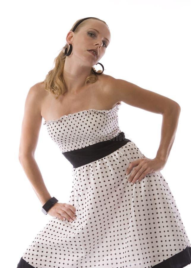Donna in vestito dal puntino di Polka immagini stock