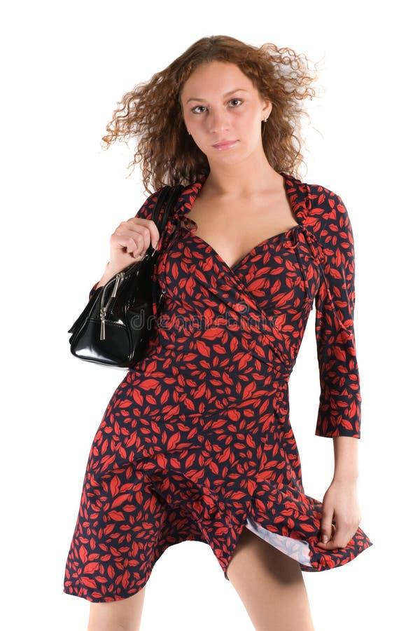 Donna in vestito rosso-nero fotografie stock libere da diritti