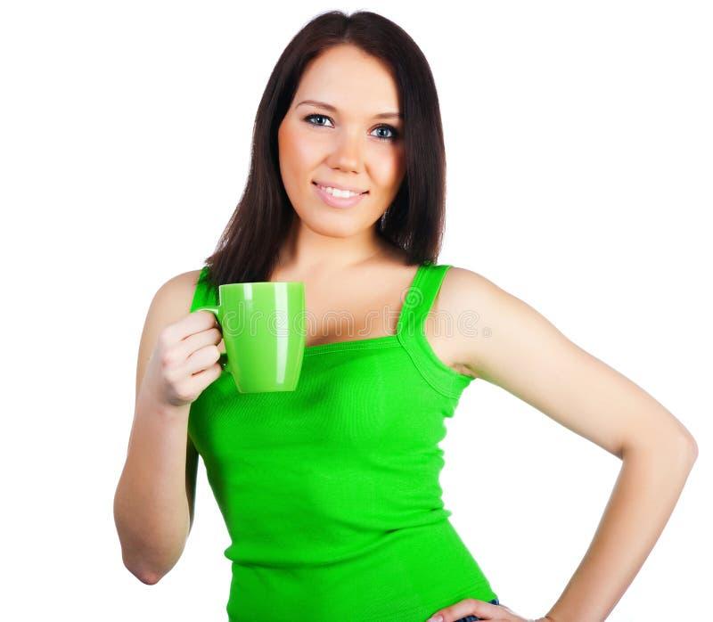 Donne abbastanza giovani con la tazza di tè fotografie stock