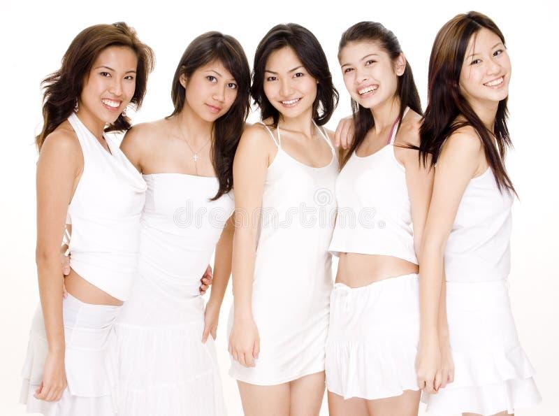 Donne asiatiche in #4 bianco fotografia stock