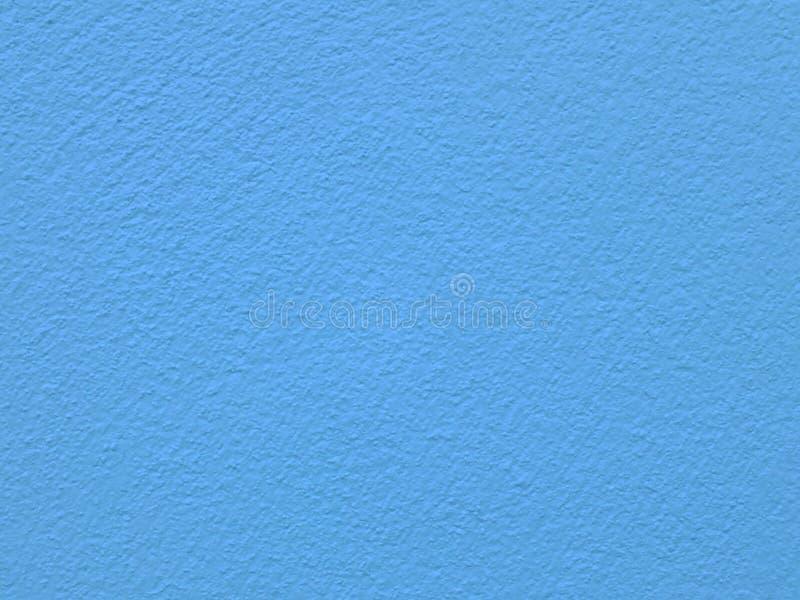 Donne au fond une consistance rugueuse bleu grunge de mur en béton photographie stock