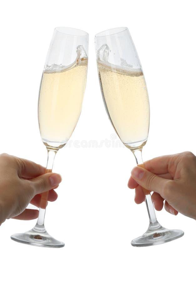 Donne che tostano con i vetri di champagne immagini stock