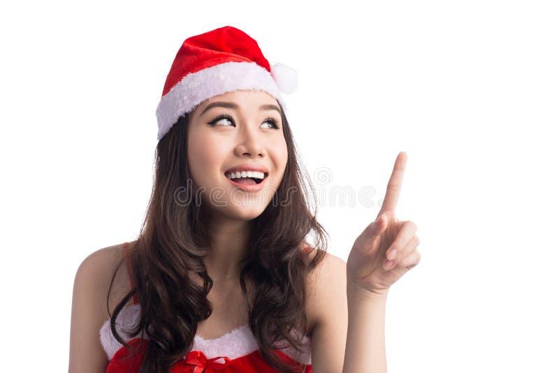 Donne della Santa con i sacchetti La bellezza Girl di modello asiatico in Santa Hat ha isolato la o immagine stock