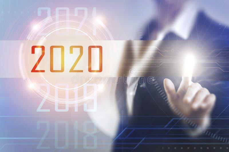 Donne di affari che toccano lo schermo 2020 immagini stock