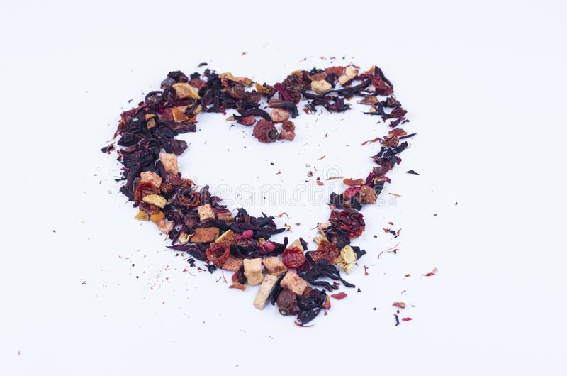Donnez à exprimer une consistance rugueuse la sympathie pour le thé de fruit Thé en forme de coeur photo libre de droits