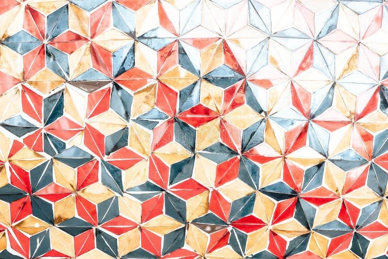 Donnez à un style une consistance rugueuse plus ancien de handmake de vintage d'illustration de mur de triangle de couleur photos stock