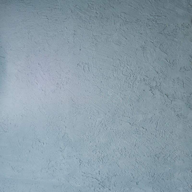 Donnez au stuc une consistance rugueuse vénitien bleu décoratif pour des milieux photos stock
