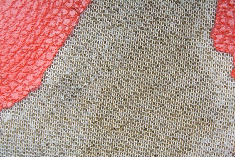 Donnez au vieux cuir une consistance rugueuse rouge photo stock
